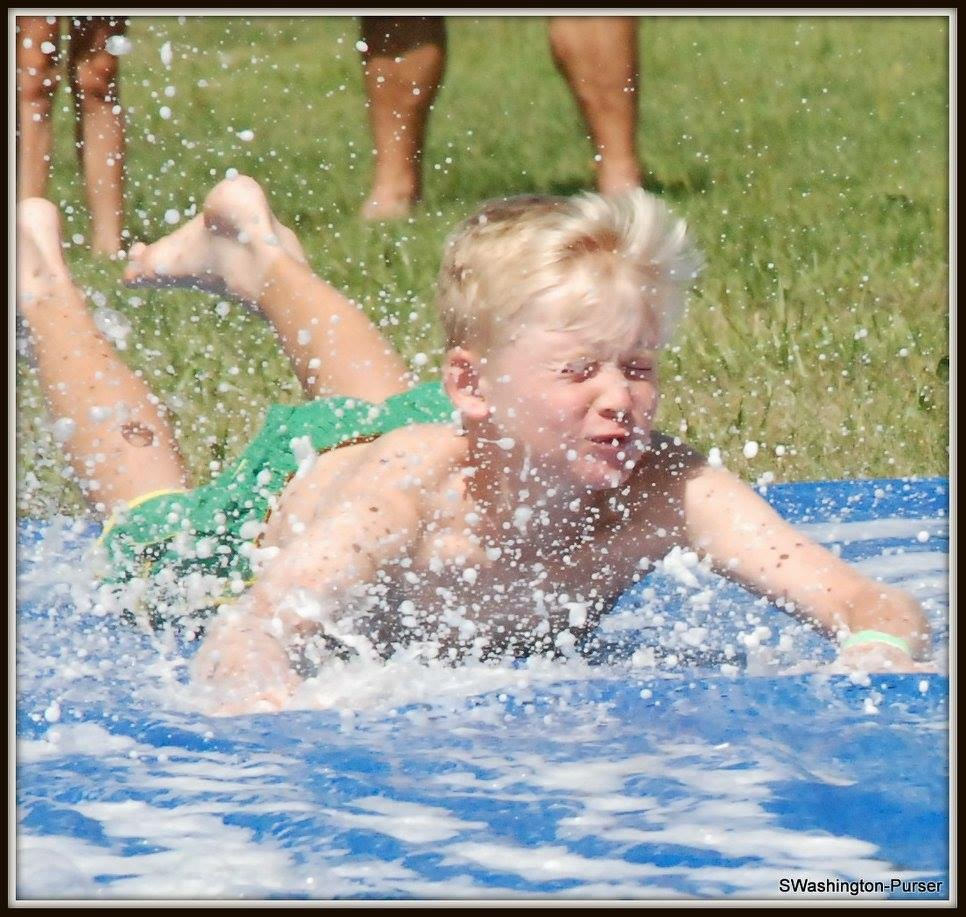 Child playing on a slip and slide