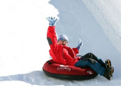 Person snow tubing