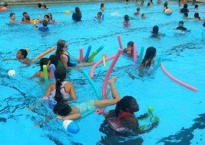 campers in the pool with pool noodles