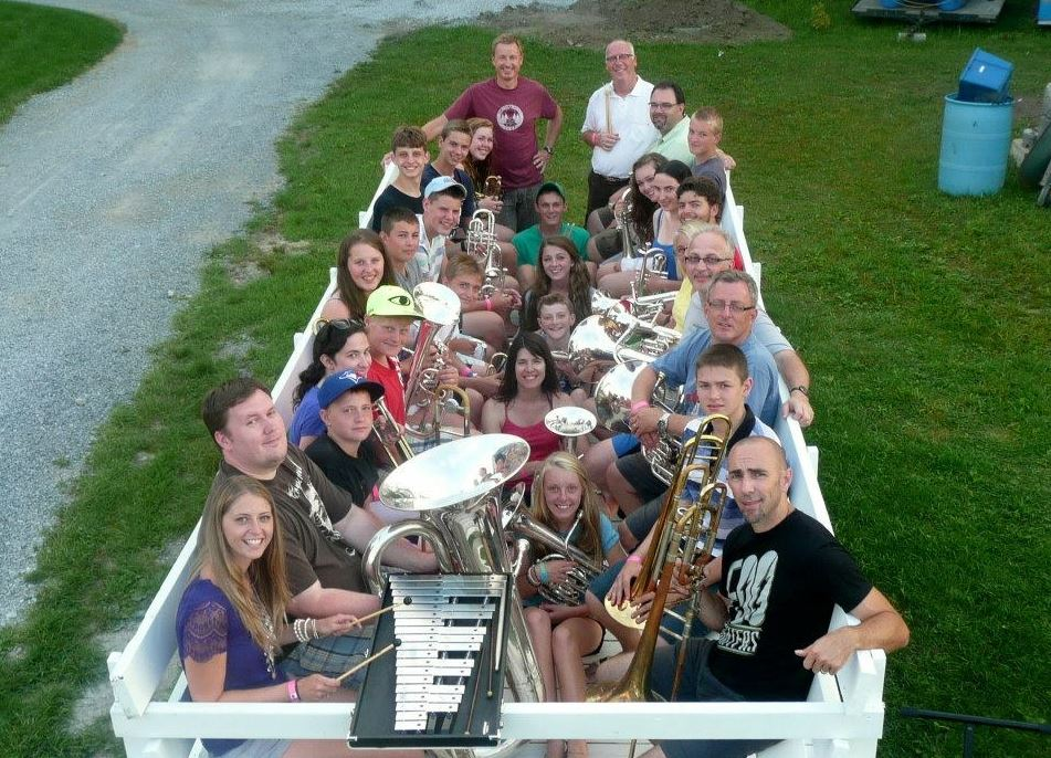 Band group from Senior Music Camp posing in the hay wagon