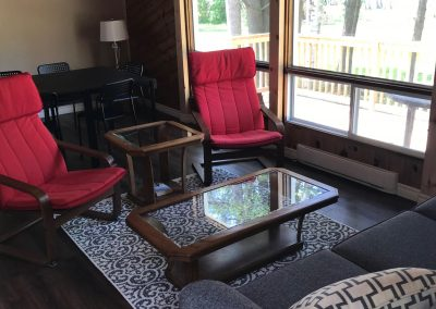 Interior view of the living room in the Papa Bear Cabin at Newport