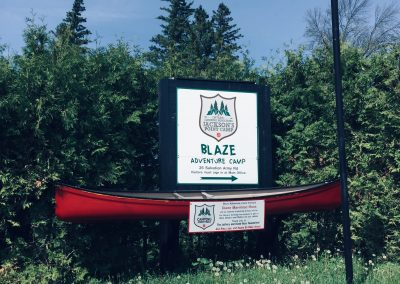 Entrance to the Blaze Site, sign and canoe