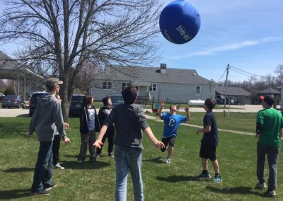 Youth Playing with a Kinball