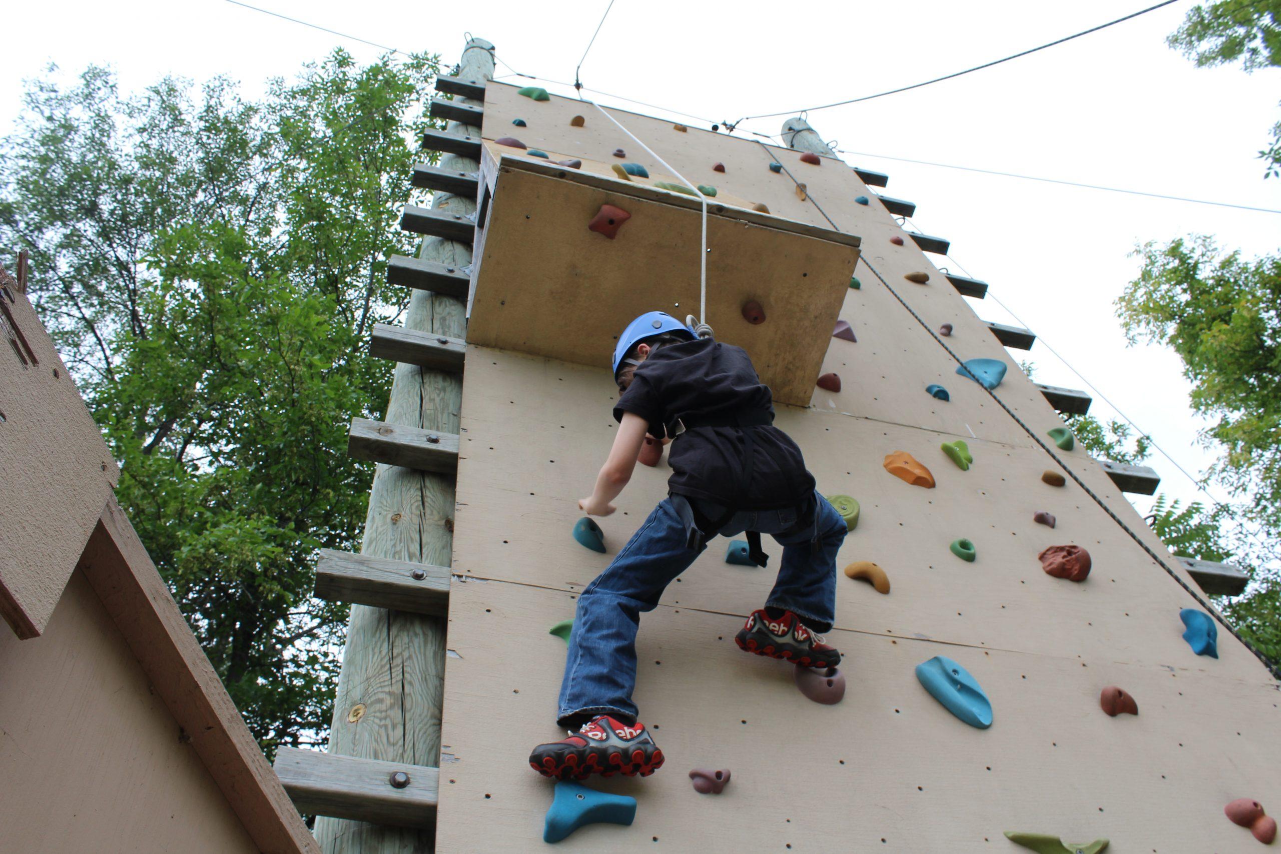 camper rock climbing