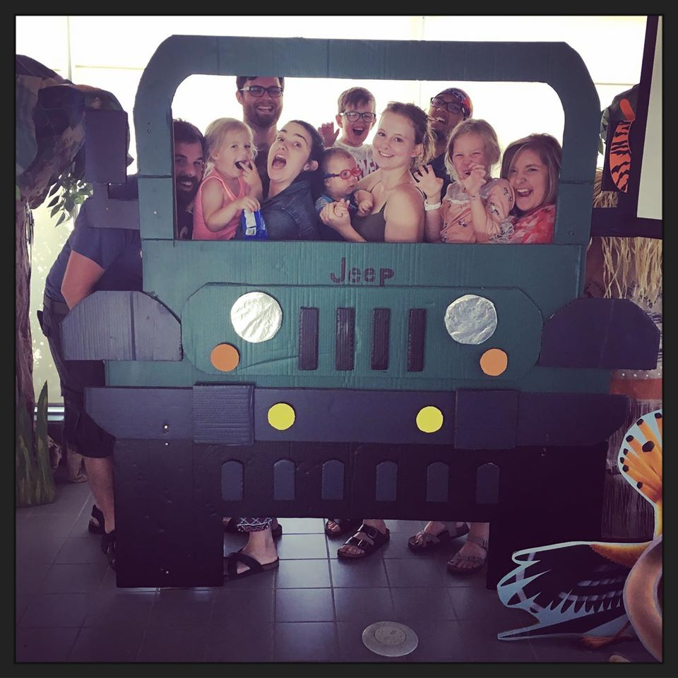 campers and staff in jeep photo booth